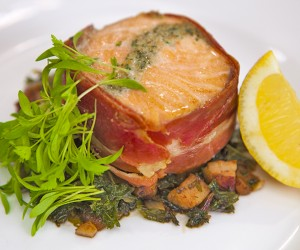 Salmon Wrapped in Prosciutto with Sauteed Kale