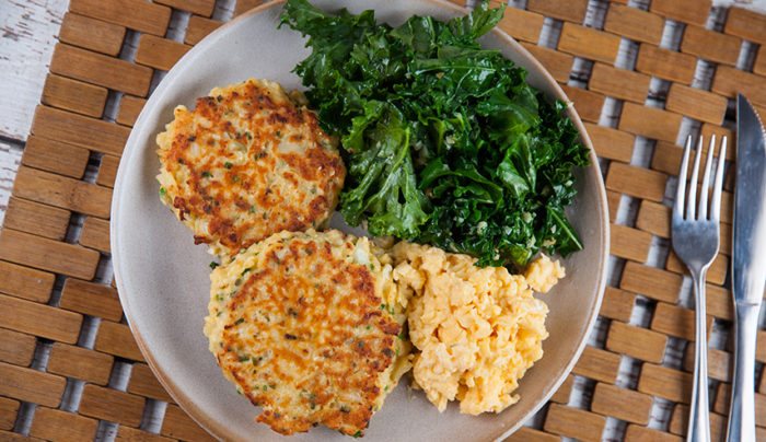 Cauliflower Hash Browns with Scrambled Eggs & Garlic Kale